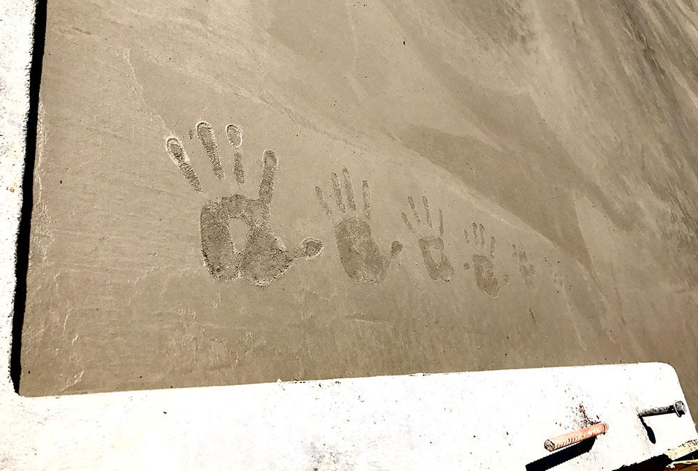 hands in wet cement