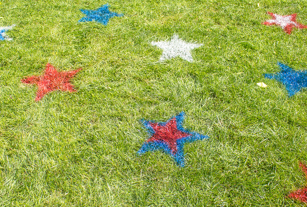 red, white, and blue stars painted on grass