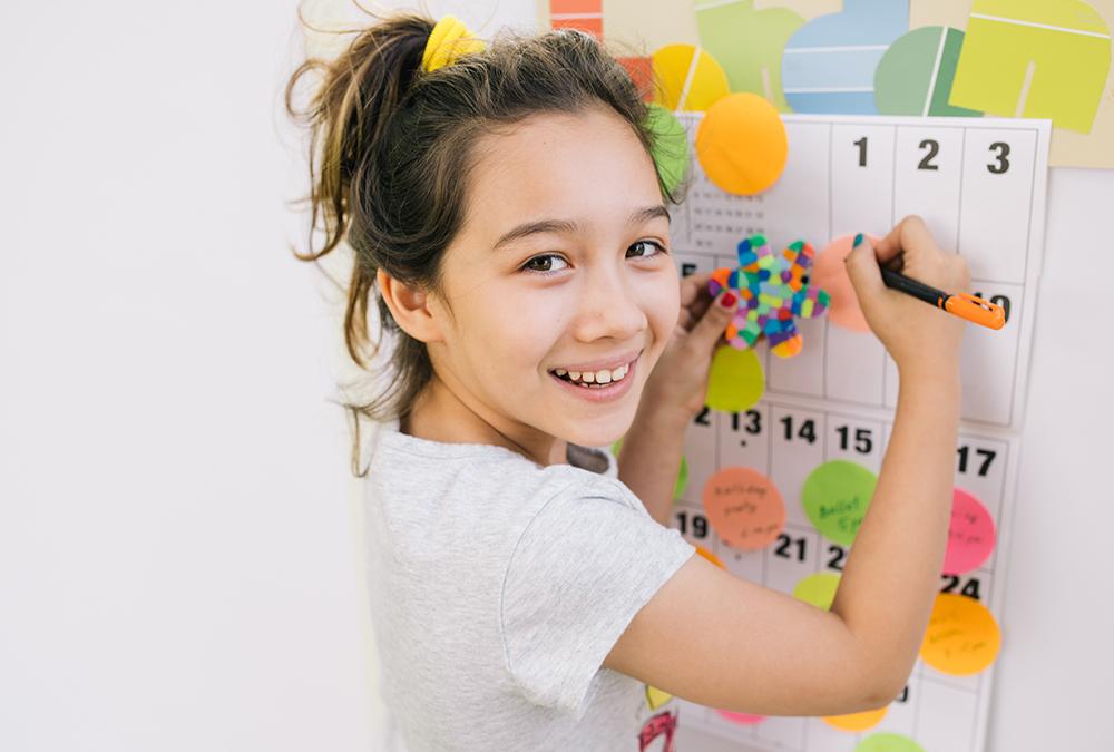 child using dry erase board
