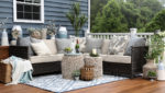 outdoor deck featuring sofas, pillows, and rugs